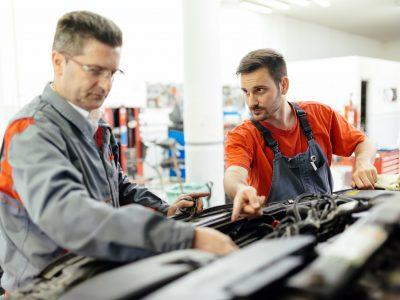 Car mechanic fixing a car